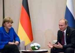 Putin Briefed Merkel on Russias Efforts in Helping Syrian Refugees During Talks - Kremlin