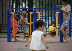 Given the right to larger families, Chinese may hold off