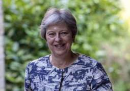 May Says Wants UK to Become G7's Largest Investor in Africa by 2022