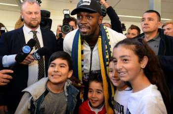 sain Bolt arrives in Australia on football quest