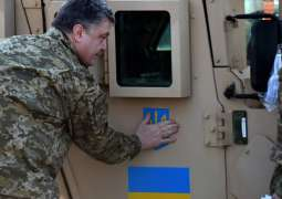Poroshenko Pledges to Not Introduce Martial Law in Donbas Following Death of DPR Leader