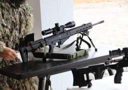 Putin Shoots SVCh Rifle at Kalashnikov Concern Center at Russia's Patriot Military Park