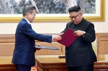 N. Korea's Kim says to visit Seoul, shut missile site