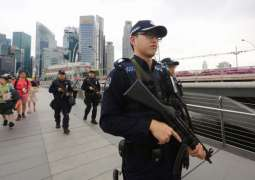 Singapore editor charged with defaming government