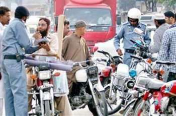 Tractor-trolley driver being provided awareness about rules in Faisalaabd