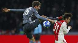 Bayern star Mueller apologises for horror kick on Ajax defender