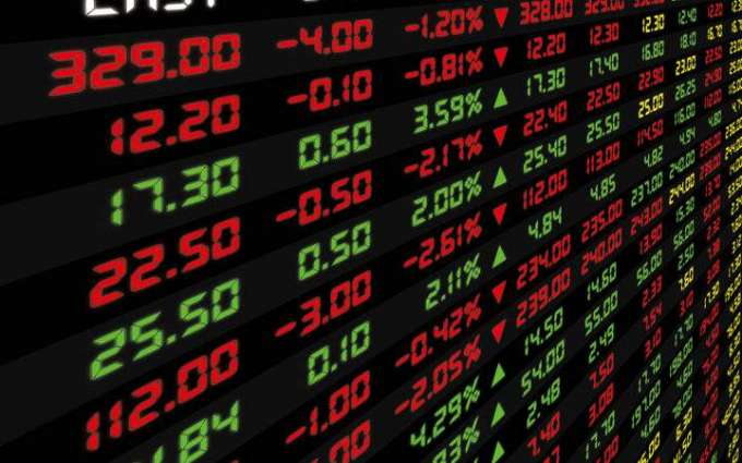 Asian markets edge higher at end of painful week