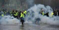 Paris Police Fire Water Cannon at Yellow Vest Protesters