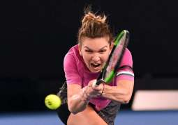Top seed Halep cools Open expectations after early scare