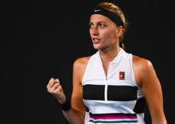 In-form Kvitova steams into Open third round