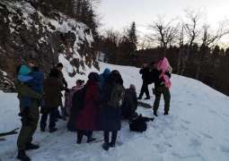 Croatian police rescue freezing migrants on snowy mountain