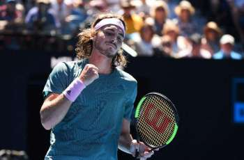 Cool Tsitsipas flies into 'fairytale' first Slam semi-final