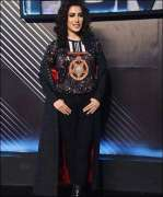 Mehwish Hayat walks the ramp wearing Tamgha-e-Imtiaz printed T-shirt