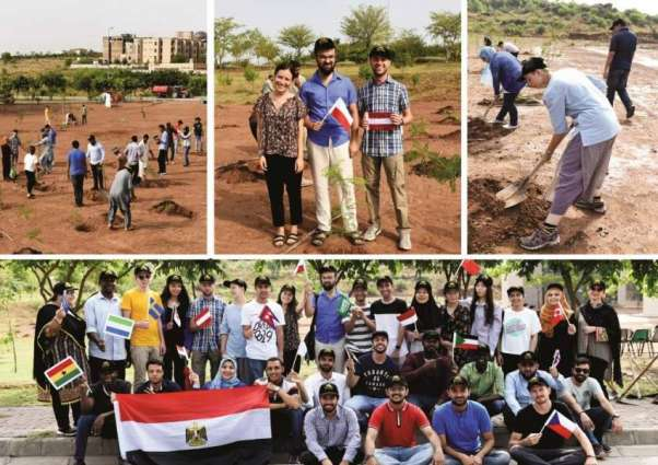 Foreign students join plantation drive at NUST