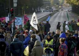 Over 90 Activists Detained in Amsterdam for Blocking Busy Street in City Center - Police