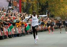 Kenyan Runner Kipchoge Sets World Record by Breaking Two-Hour Marathon Barrier