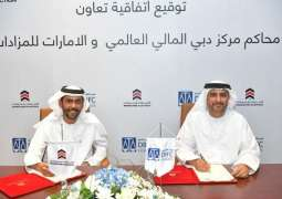 DIFC Courts, Emirates Auction sign cooperation agreement