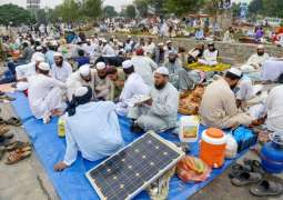 JUI-F workers carry solar panels, batteries to charge cell phones