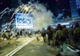 Hong Kong Police Use Tear Gas to Disperse Protesters in Central District