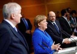 Germany's Next Social Democrat Co-Leaders Say Won't Immediately Disband Coalition