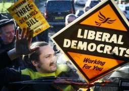 Extinction Rebellion Climate Activist Glues Himself to Liberal Democrat Bus in London