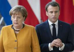 Macron, Merkel to Brief EU Leaders on Implementation of Minsk Accords on Thursday - Source
