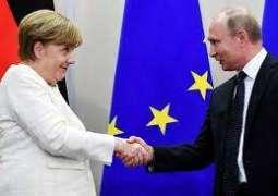 Libya and Iran top agenda in Merkel-Putin meeting