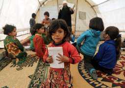 Having fled bombing, Syrian children learn to read in tent schools