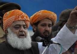 """JUI-F Chief calls PTI govt as """"illegitimate"""", vows to continue struggle against it"""