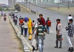 Caravan of Migrant Workers Flocks Back to India's Uttar Pradesh State Ahead of Lockdown