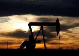 US Crude Oil Breaks Below $20 Per Barrel Before Closing at 18-Year Lows