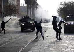 Chilean Police Use Water Cannons, Tear Gas Against Protesters in Santiago - Reports