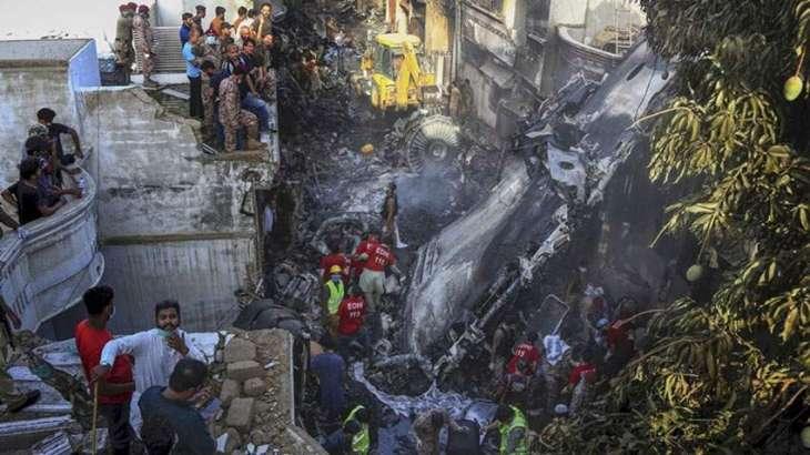 97 killed as plane crashes into residential area near Karachi airport