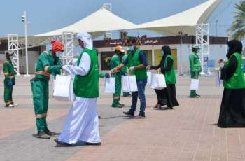 Abu Dhabi City Municipality providing water, juices, umbrellas to outdoor workers