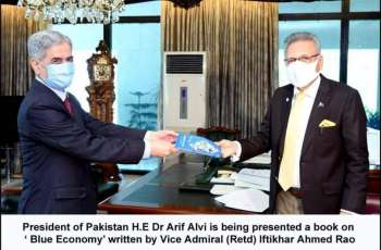 PRESIDENT ARIF ALVI WAS PRESENTED WITH BOOK ON 'BLUE ECONOMY' WRITTEN BY VICE ADMIRAL (R) IFTIKHAR AHMED RAO