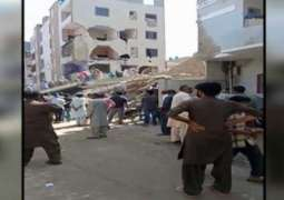 Four-story building collapses in Korangi Town