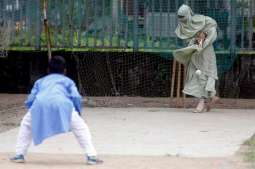Bangladeshi woman, her son's pictures playing cricket go viral