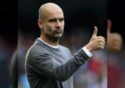 Guardiola commits to Manchester City by signing new contract to 2023