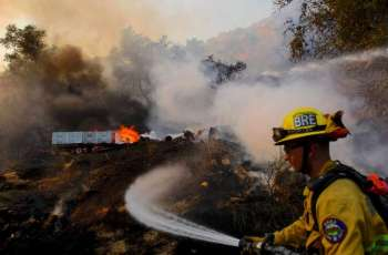 Two Firemen Injured, 25,000 Americans Evacuated in California's Bond Fire - Fire Authority