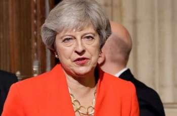 Theresa May Chides Johnson for 'Abandoning' UK Global 'Moral' Leadership