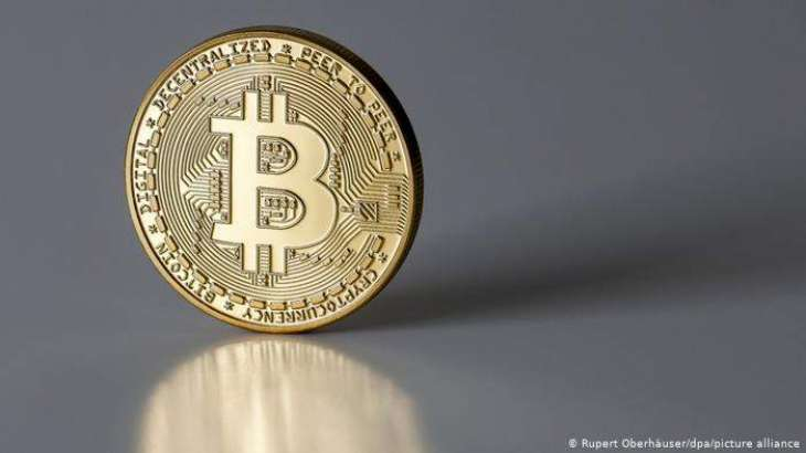 Bitcoin quickly slips from record highs: Reports