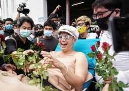 Thai Singer Confesses to Burning King's Portrait After Arrest ' Reports