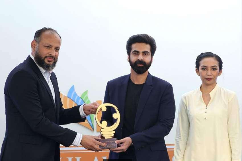 Moonis Alvi presenting award to Khaqan Sikander and Nazia Bilal