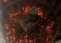 Holy Fire Descends at Church of Holy Sepulcher in Jerusalem
