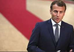 France's Macron Urges US to Lift Curbs on Vaccine Exports