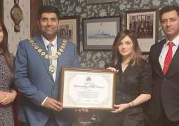 Armeena Khan receives certificate over public service in the UK