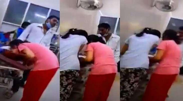 شاھد : فتاة تنفخ الأکسجین فی فم والدتھا وھی مصابة بکورونا فی الھند