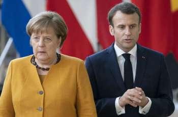 Kiev Concerned by Macron, Merkel's Initiative to Resume EU Summits With Russia