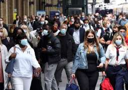 Most People in UK to Keep Wearing Face Masks When COVID-19 Restrictions Are Lifted -Survey