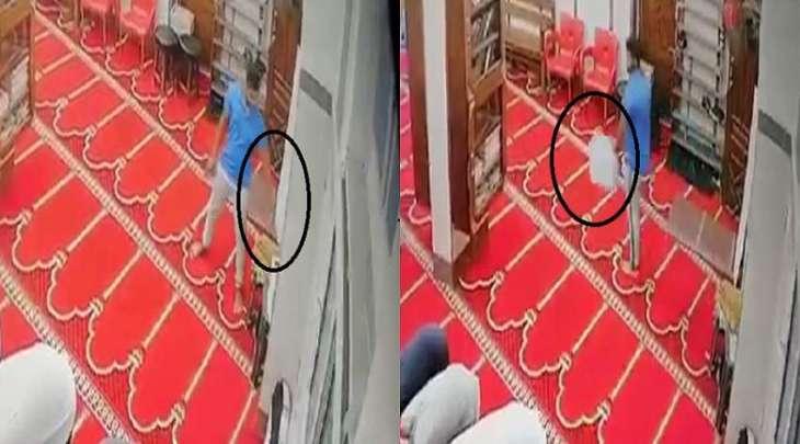 شاب یسرق صندوق التبرعات من داخل مسجد خلال تأدیة الصلاة فی جمھوریة مصر